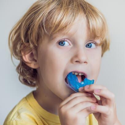Boy testing out mouthguard