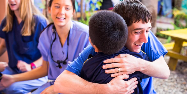 Dr Patrick hugging patient