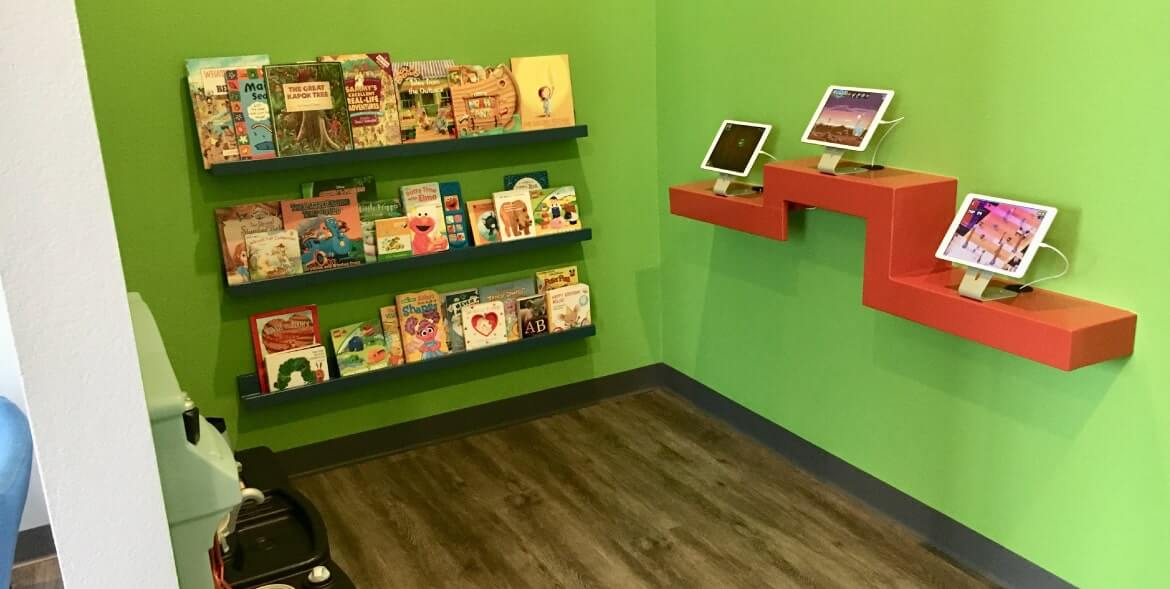 Childrens play area with iPads and books