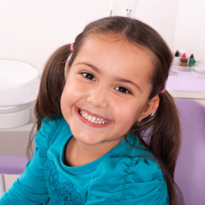 Girl smiling at the dentist