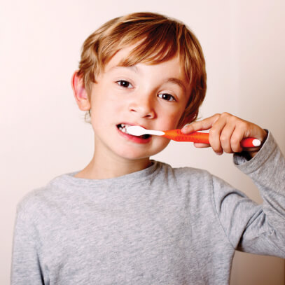 Photo of child brushing teeth
