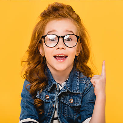Young girl with glasses pointing up